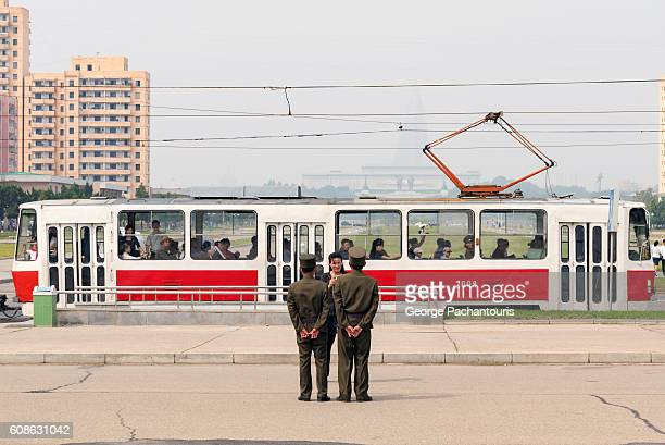 north korea soldiers taking picture in pyongyang - korean military stock photos and pictures