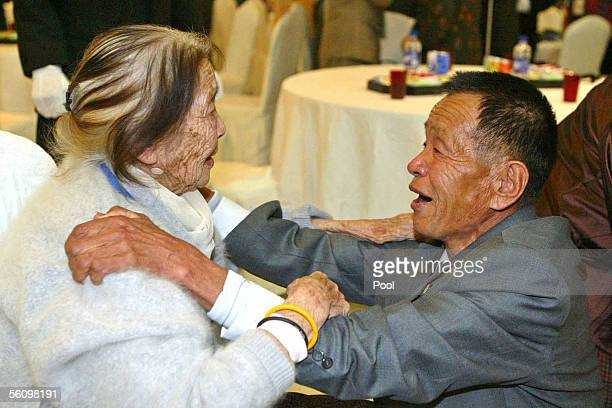 North Korean Ahn MyungJo hug his South Korean mother Kang JungSoon during the 12th reunion since the two Koreas agreed to promote peace and...