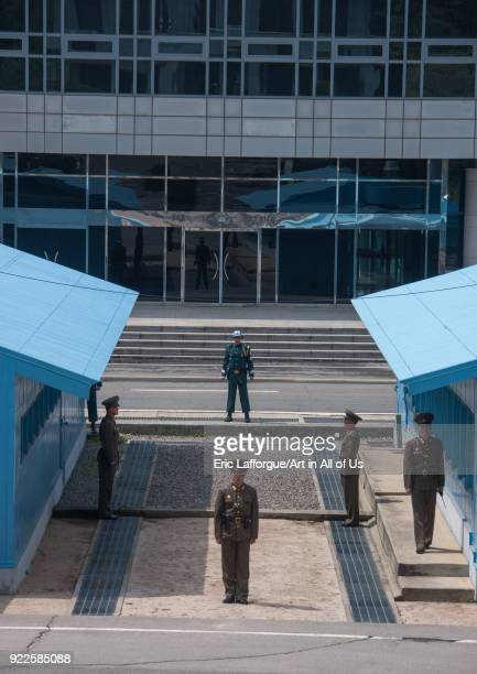 North Korean and south Korean soldiers standing in front of the United Nations conference rooms on the demarcation line in the Demilitarized Zone,...