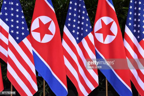 North Korean and US flags stand side by side at the location where North Korea's leader Kim Jong Un will meet with US President Donald Trump for a...
