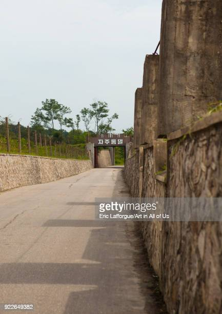North Korean anti tank invasion concrete blocks on the roadside on the Demilitarized Zone, North Hwanghae Province, Panmunjom, North Korea on...