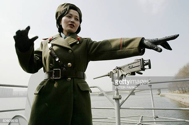 North Korean army guide Kim MiGyong explains events on the deck of the USS Pueblo a 538metrelong ship the North Koreans seized in 1968 after accusing...