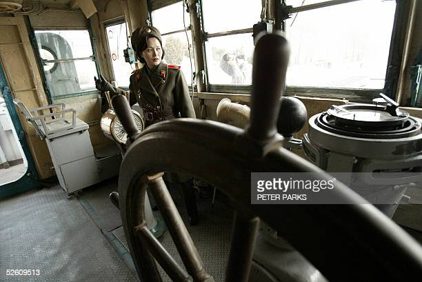 North Korean army guide Kim MiGyong looks around the bridge on the USS Pueblo a 538metrelong ship the North Koreans seized in 1968 after accusing its...