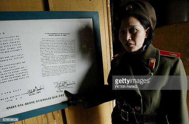 North Korean army guide Kim MiGyong shows the letter of apology on the USS Pueblo a 538metrelong ship the North Koreans seized in 1968 after accusing...