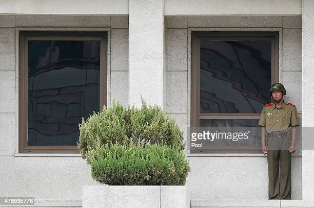 North Korean army soldier watches the south side as members of the Group of Eminent Persons of the Comprehensive NuclearTestBan Treaty Organization...