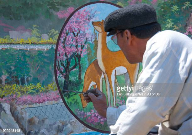 North Korean artist painting a propaganda wall in the countryside North Hamgyong Province Chilbo Sea North Korea on May 8 2010 in Chilbo Sea North...