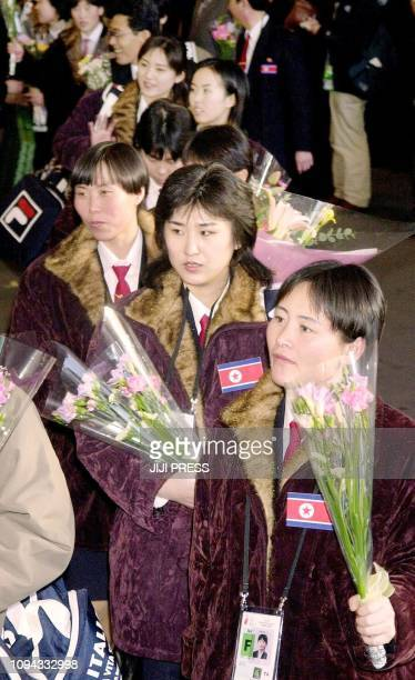 North Korean athletes and sports officials arrive at Narita's New Tokyo International Airport 28 January 2003 to take part in the Winter Asian Games...