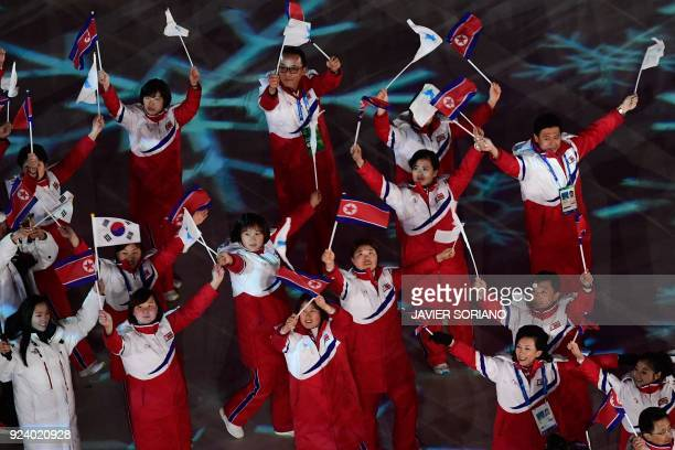 TOPSHOT North Korean athletes arrive during the closing ceremony of the Pyeongchang 2018 Winter Olympic Games at the Pyeongchang Stadium on February...