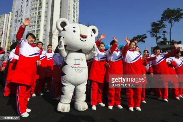 North Korean athletes take part in a welcoming ceremony for the team at the Olympic Village in Gangneung on February 8 ahead of the Pyeongchang 2018...