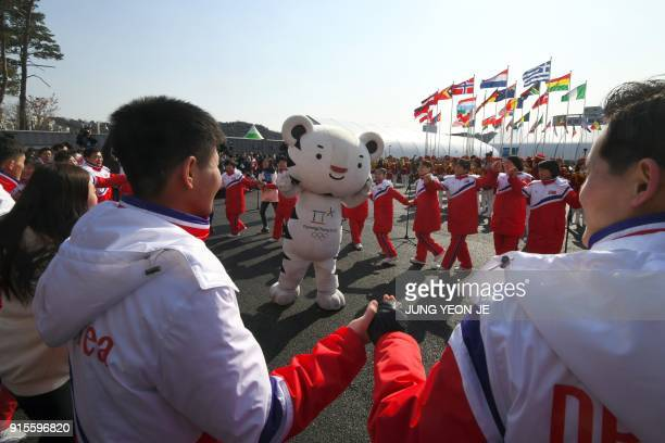 TOPSHOT North Korean athletes take part in a welcoming ceremony for the team at the Olympic Village in Gangneung on February 8 ahead of the...