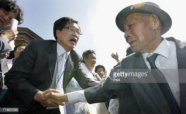 A North Korean bids farewell to his South Korean relatives after the third round of the 14th Separated Family Reunion Meeting on June 27 2006 at...