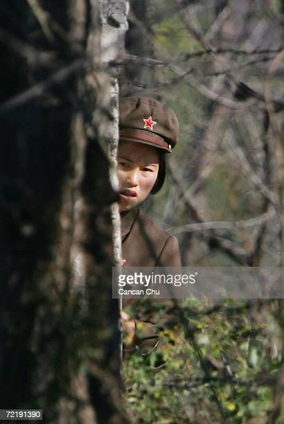 North Korean border guard looks on near the banks of the Yalu River opposite the Chinese border city of Dandong on October 17 2006 in Uiju Democratic...