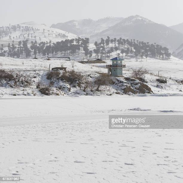 north korean border guard tower in winter - yalu river stock pictures, royalty-free photos & images