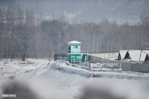 north korean border with watchtower - national border stock pictures, royalty-free photos & images