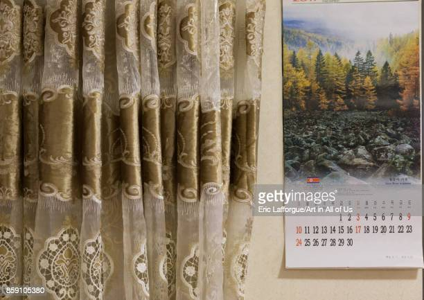 North Korean calendar and curtain during the exhibition Pyongyang sallim at architecture biennale showing a north Korean apartment replica National...