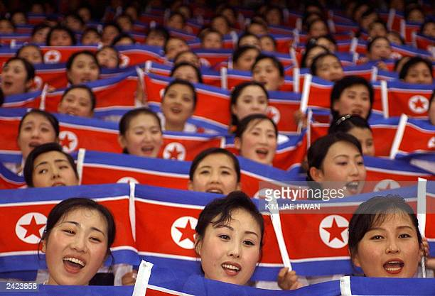 North Korean cheer team members wave their national flags during the World Students Games opening ceremony in Daegu on 21 August 2003 AFP PHOTO/KIM...