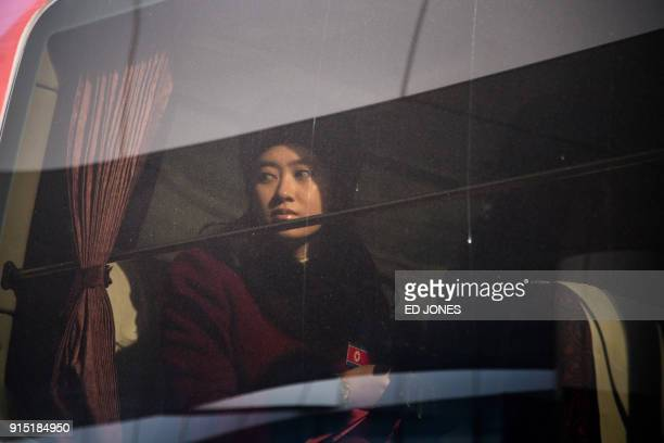 North Korean cheerleader sits aboard a bus as their convoy arrives at the Inje Speedium resort complex where they are staying during the Pyeongchang...