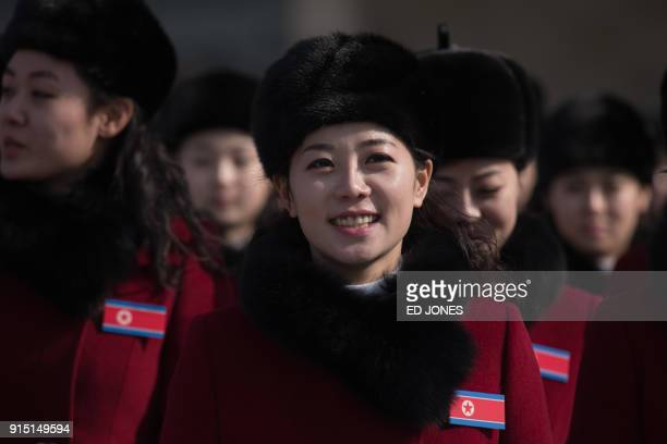 TOPSHOT North Korean cheerleaders arrive at a rest stop as their bus convoy carrying a 280member delegation on its way to the 2018 Pyeongchang winter...