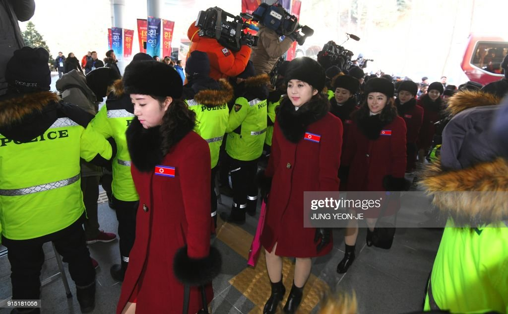North Korean cheerleaders arrive at the Inje Speedium, a racetrack and hotel complex, in Inje, north of Pyeongchang on February 7, 2018 ahead of the Pyeongchang Winter Olympic Games. More than 200 young North Korean women arrived in South Korea to root for athletes from both sides of the peninsula at the Winter Olympics. / AFP PHOTO / JUNG Yeon-Je
