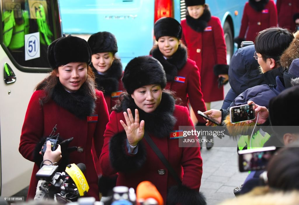 North Korean cheerleaders arrive at the Inje Speedium, a racetrack and hotel complex, in Inje, north of Pyeongchang, on February 7, 2018 ahead of the Pyeongchang Winter Olympic Games. More than 200 young North Korean women arrived in South Korea to root for athletes from both sides of the peninsula at the Winter Olympics. / AFP PHOTO / JUNG Yeon-Je