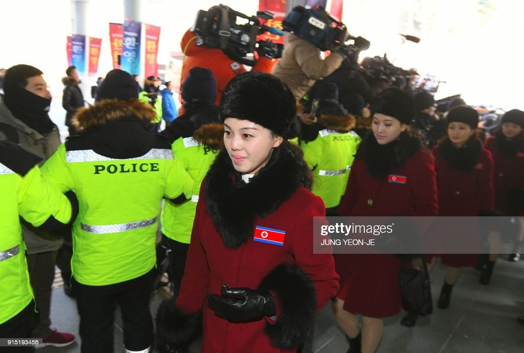 TOPSHOT - North Korean cheerleaders arrive at the Inje Speedium, a racetrack and hotel complex, in Inje, north of Pyeongchang on February 7, 2018 ahead of the Pyeongchang Winter Olympic Games. More than 200 young North Korean women arrived in South Korea to root for athletes from both sides of the peninsula at the Winter Olympics. / AFP PHOTO / JUNG Yeon-Je