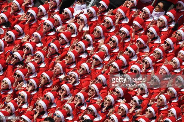 North Korean cheerleaders attend the Men's Slalom at the Yongpyong Alpine Centre during the Pyeongchang 2018 Winter Olympic Games in Pyeongchang on...