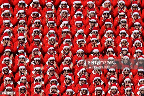 TOPSHOT North Korean cheerleaders attend the Men's Slalom at the Yongpyong Alpine Centre during the Pyeongchang 2018 Winter Olympic Games in...