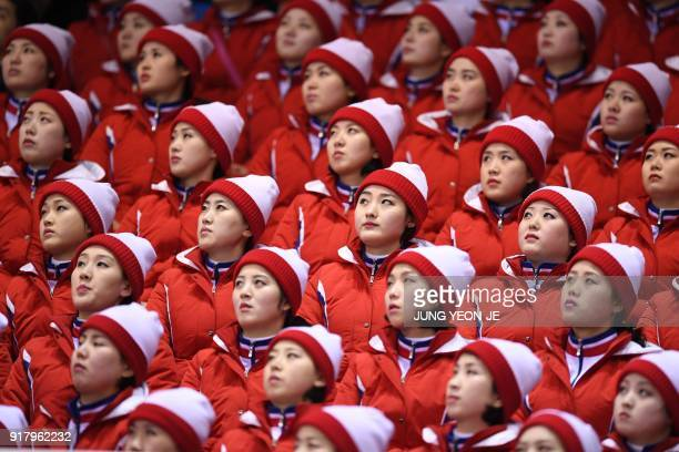 North Korean cheerleaders attend the pair skating short program of the figure skating event during the Pyeongchang 2018 Winter Olympic Games at the...