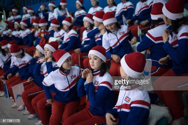 North Korean cheerleaders attend the women's preliminary round ice hockey match between Sweden and Unified Korea during the Pyeongchang 2018 Winter...
