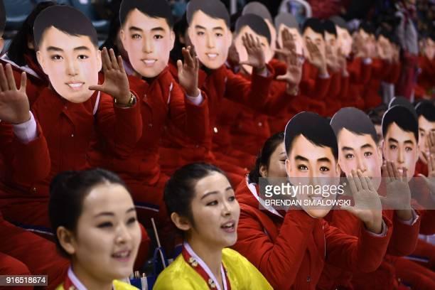 TOPSHOT North Korean cheerleaders cheer during the women's preliminary round ice hockey match between Switzerland and the Unified Korean team during...