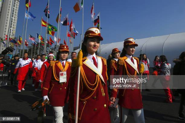 TOPSHOT North Korean cheerleaders leave after a welcoming ceremony for North Korea's Olympic team at the Olympic Village in Gangneung on February 8...