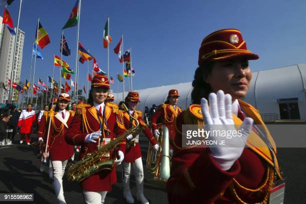 North Korean cheerleaders leave after a welcoming ceremony for North Korea's Olympic team at the Olympic Village in Gangneung on February 8, 2018...
