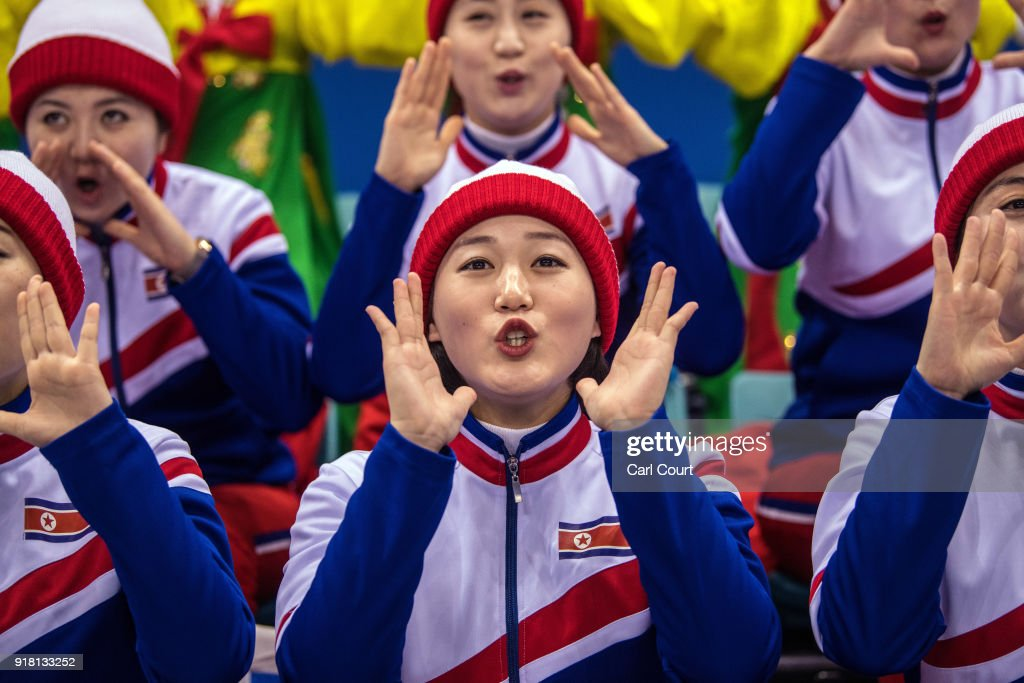 North Korean cheerleaders perform during the Women's Ice Hockey Preliminary Round Group B game between Korea and Japan on day five of the PyeongChang 2018 Winter Olympics at Kwandong Hockey Centre on February 14, 2018 in Gangneung, South Korea. Strong winds have caused a number of events to be rescheduled at the PyeongChang Winter Olympics including the biathlon and Alpine skiing competitions.