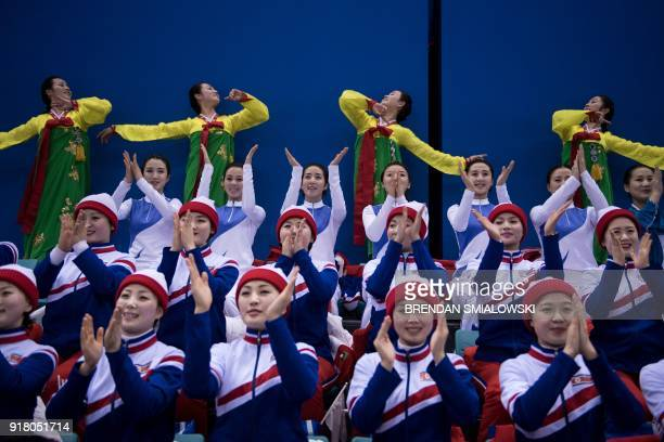 North Korean cheerleaders perform for a women's preliminary round ice hockey match between Unified Korea and Japan during the Pyeongchang 2018 Winter...
