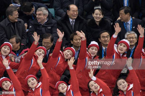TOPSHOT North Korean cheerleaders performs before South Korea's president Moon Jaein president of the International Olympic Committee Thomas Bach...