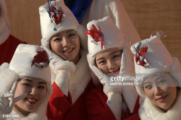 TOPSHOT North Korean cheerleaders pose for a photograph during the Women's Giant Slalom at the Yongpyong Alpine Centre during the Pyeongchang 2018...