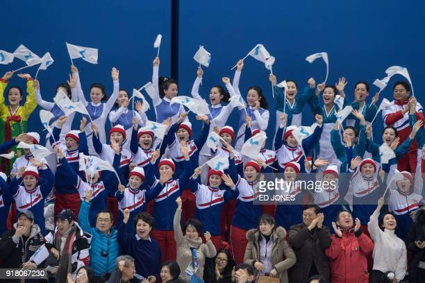 TOPSHOT North Korean cheerleaders react after the Unified Korean team scored against Japan in the women's preliminary round ice hockey match between...