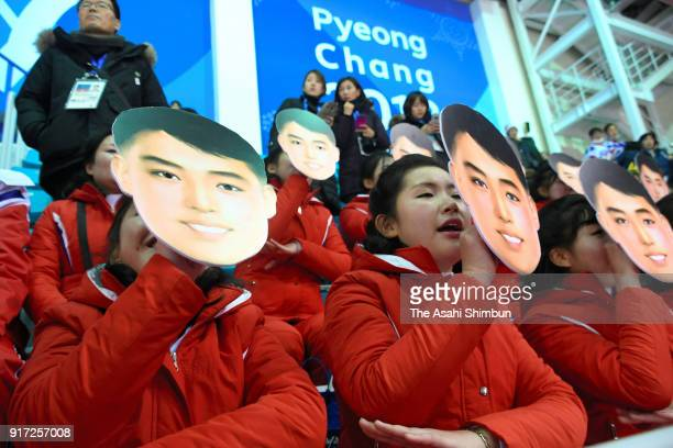 North Korean cheerleaders sing and wave with holding masks during the Women's Ice Hockey Preliminary Round Group B game between Switzerland and Korea...
