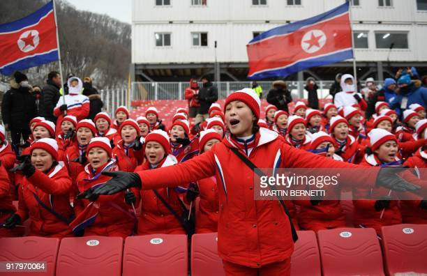 TOPSHOT North Korean cheerleaders sing as the Alpine Skiing Women's Slalom was cancelled due to weather conditions at the Jeongseon Alpine Center...