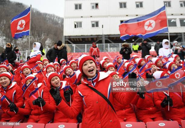 North Korean cheerleaders sing as the start of the Alpine Skiing Women's Slalom was delayed due to weather conditions at the Jeongseon Alpine Center...