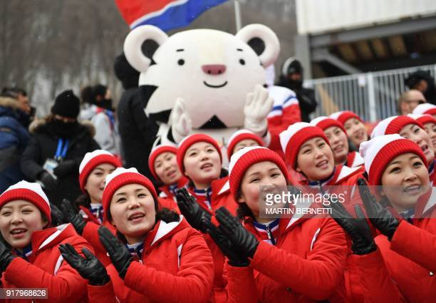 TOPSHOT North Korean cheerleaders sing before the start of the Alpine Skiing Women's Slalom after it was delayed due to weather conditions at the...