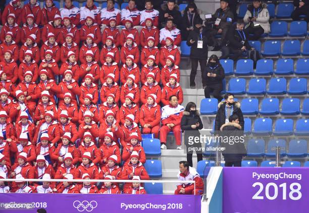 North Korean cheerleaders sitting in the tribunes during the figure skating free skate event of the 2018 Winter Olympics in the Gangneung Ice Arena...