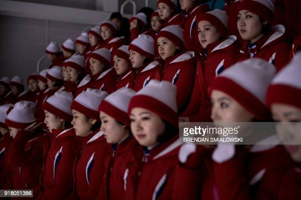 North Korean cheerleaders wait for a women's preliminary round ice hockey match between Unified Korea and Japan during the Pyeongchang 2018 Winter...
