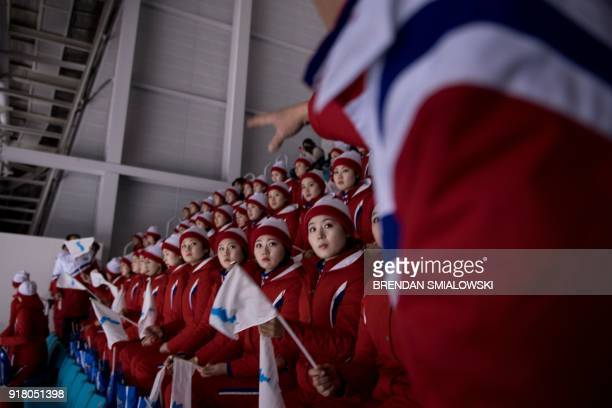 TOPSHOT North Korean cheerleaders wait for a women's preliminary round ice hockey match between Unified Korea and Japan during the Pyeongchang 2018...