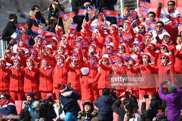 TOPSHOT North Korean cheerleaders wave their national flag during the Men's Giant Slalom at the Jeongseon Alpine Center during the Pyeongchang 2018...