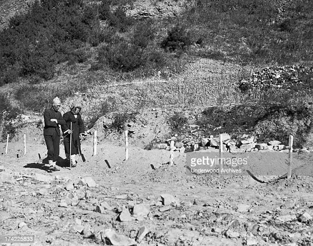 North Korean couple look for their son's grave at Duk San Nichel Mine where retreating North Korean communists killed over 1000 anti-communists,...