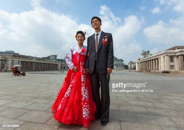 North Korean couple newly wed in Kim il Sung square Pyongan Province Pyongyang North Korea on September 9 2012 in Pyongyang North Korea