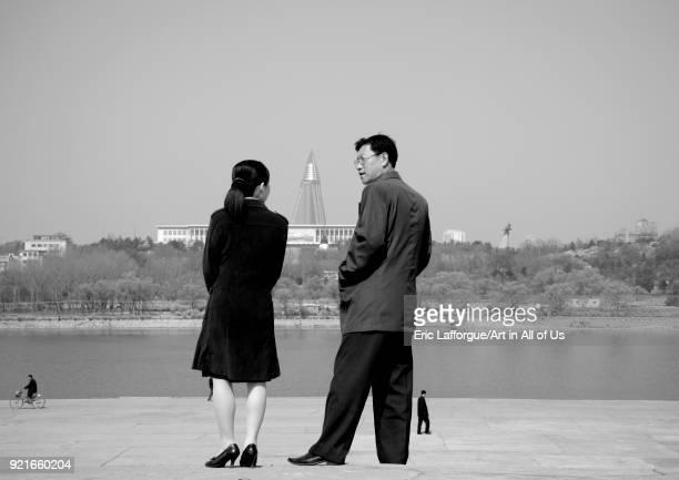 North Korean couple on the banks of the Taedong river Pyongan Province Pyongyang North Korea on April 25 2010 in Pyongyang North Korea