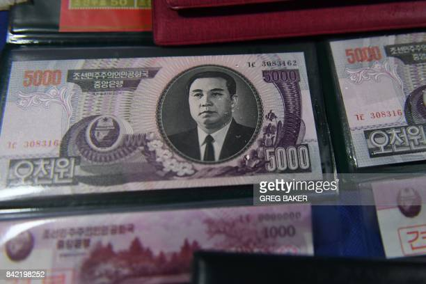 North Korean currency is seen at a Chinese vendor's stall in the border city of Dandong opposite the North Korean town of Sinuiju in China's...