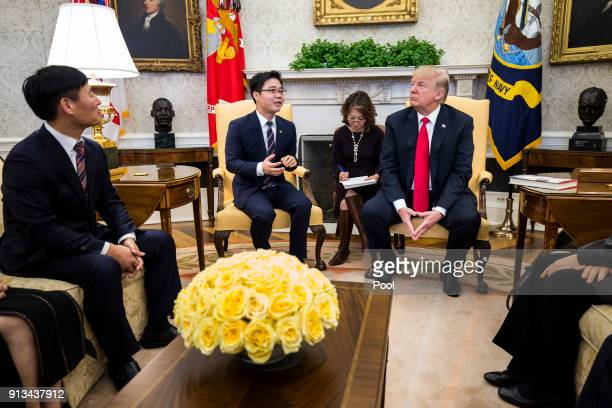 North Korean defector Ji Seongho speaks US President Donald Trump meets with North Korean defectors in the Oval Office of the White House on February...